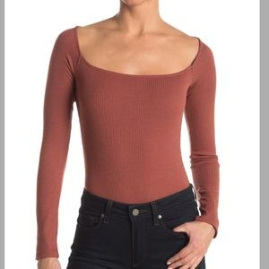 New with tags Long sleeved bodysuit